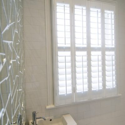 89mm Slat White Full Height Shutters With A Mid Rail Outside Mounted